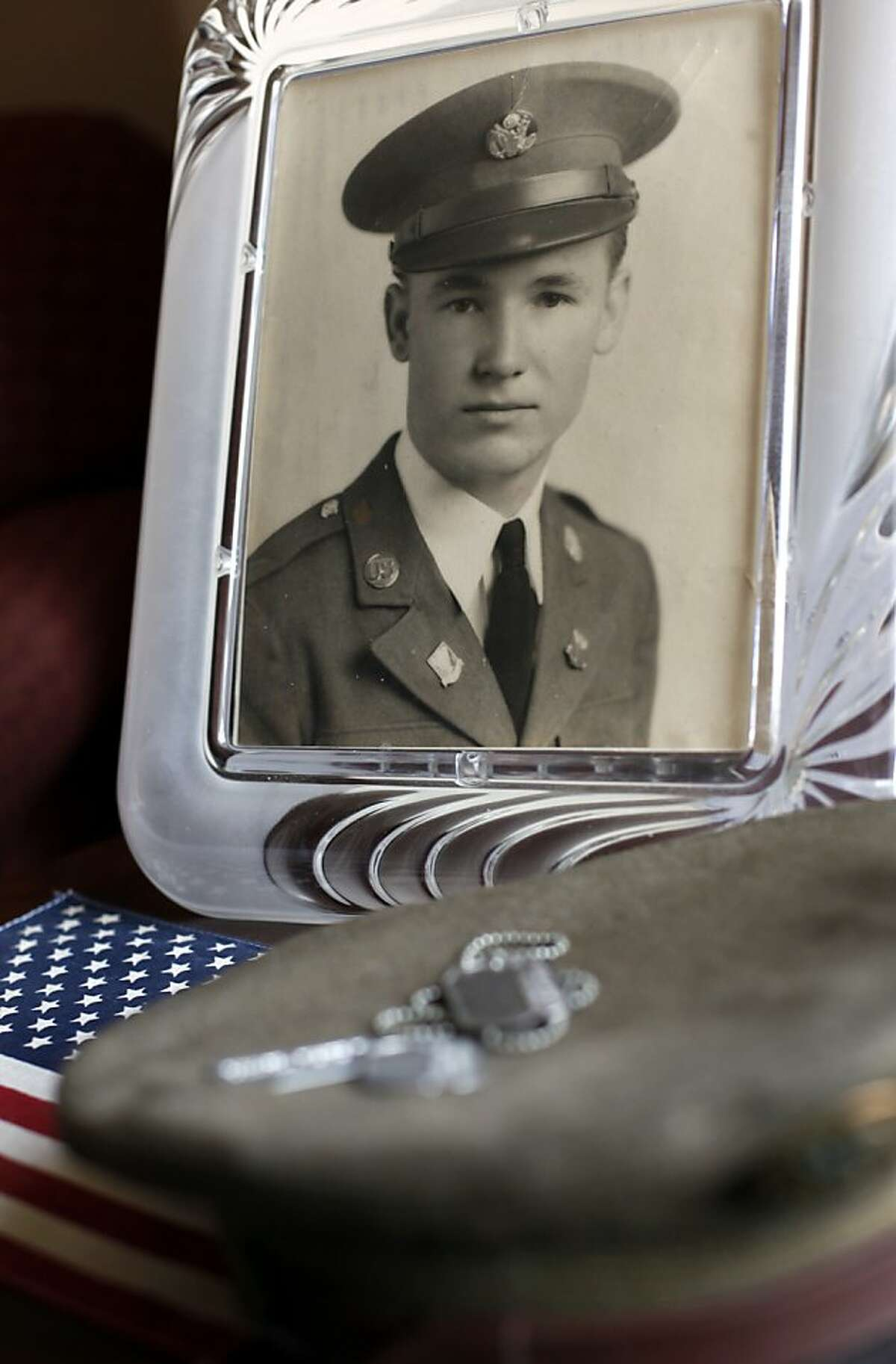 A photo, dog tags and the hat belonging to Elbert Pollard are shown in San Francisco, Calif. Thursday, May 24, 2012. Pollard was a 28-year-old Air Force gunner in 1950 when he died parachuting out of a B-36. His remains were finally identified by DNA this year, and Friday they will be laid to rest in the Presidio.