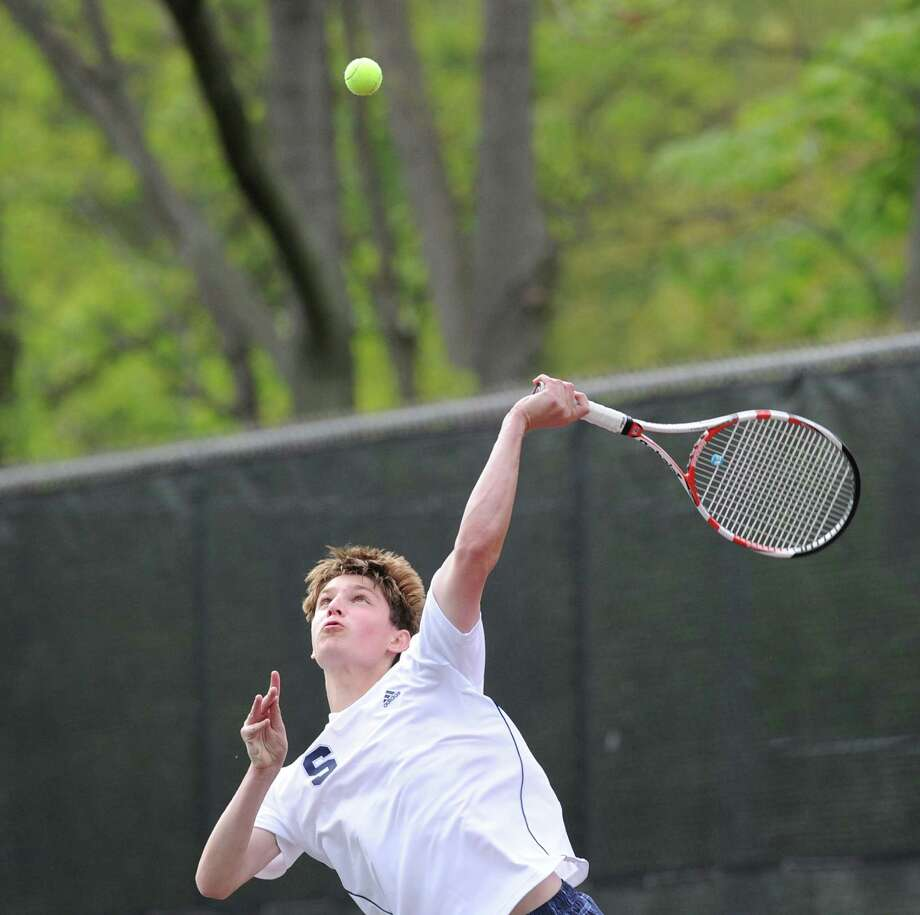 Staples' Graham Hyman serves against Greenwich May 1. Hyman won 6-0, 6-2 at second singles Thursday in a 4-0 win over Ridgefield in the FCIAC semifinals. Photo: Bob Luckey, Bob Luckey / Staff Photographer / Greenwich Time