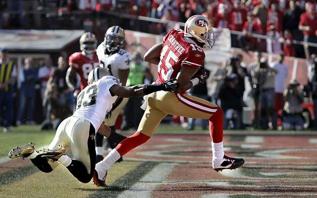 49ers' Michael Crabtree, (15) beats the Saints  Jabari Greer, (33) on a first half touchdown, as the San Francisco 49ers take on the New Orleans Saints in the NFC divisional playoffs, on Saturday Jan. 14, 2012,  in San Francisco, Ca. Photo: Michael Macor, The Chronicle