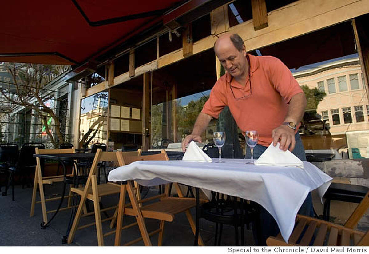 SAN FRANCISCO - SEPTEMBER 11: Baker Street Bistro owner Jaques Manuera sets up the outside tables at Baker Street Bistro on September 11, 2006 in San Francisco, California. (Photo by David Paul Morris/The Chronicle)