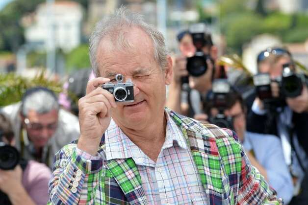 "Turning the tables: Actor Bill Murray takes a picture with a small camera during the photocall of ""Moonrise Kingdom."" (AFP/Getty Images)"