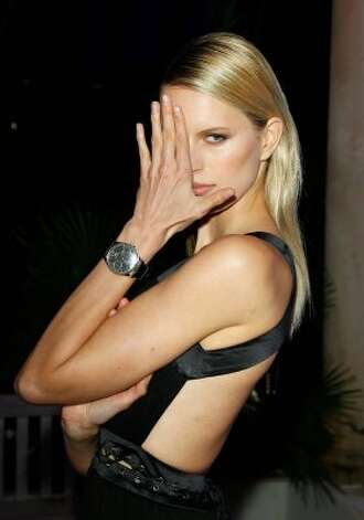 Pose: Karolina Kurkova arrives at the exclusive Filmmakers Dinner during the Cannes International Film Festival hosted by Swiss watch manufacturer IWC Schaffhausen in partnership with Finch's Quarter