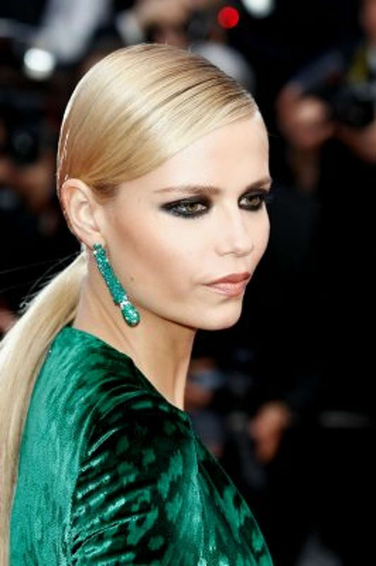 Striking in green: Natasha Poly attends the