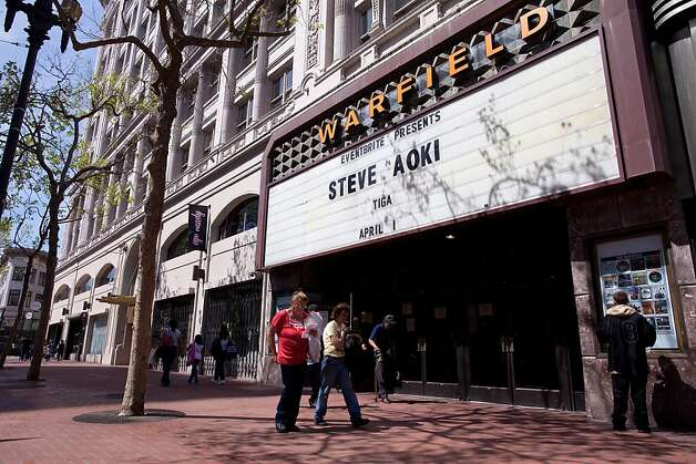 People walk in front of the Warfield on Market Street, April 1, 2011 in San Francisco, Calif.  Photograph by David Paul Morris/Special to the Chronicle Photo: David Paul Morris, Special To The Chronicle