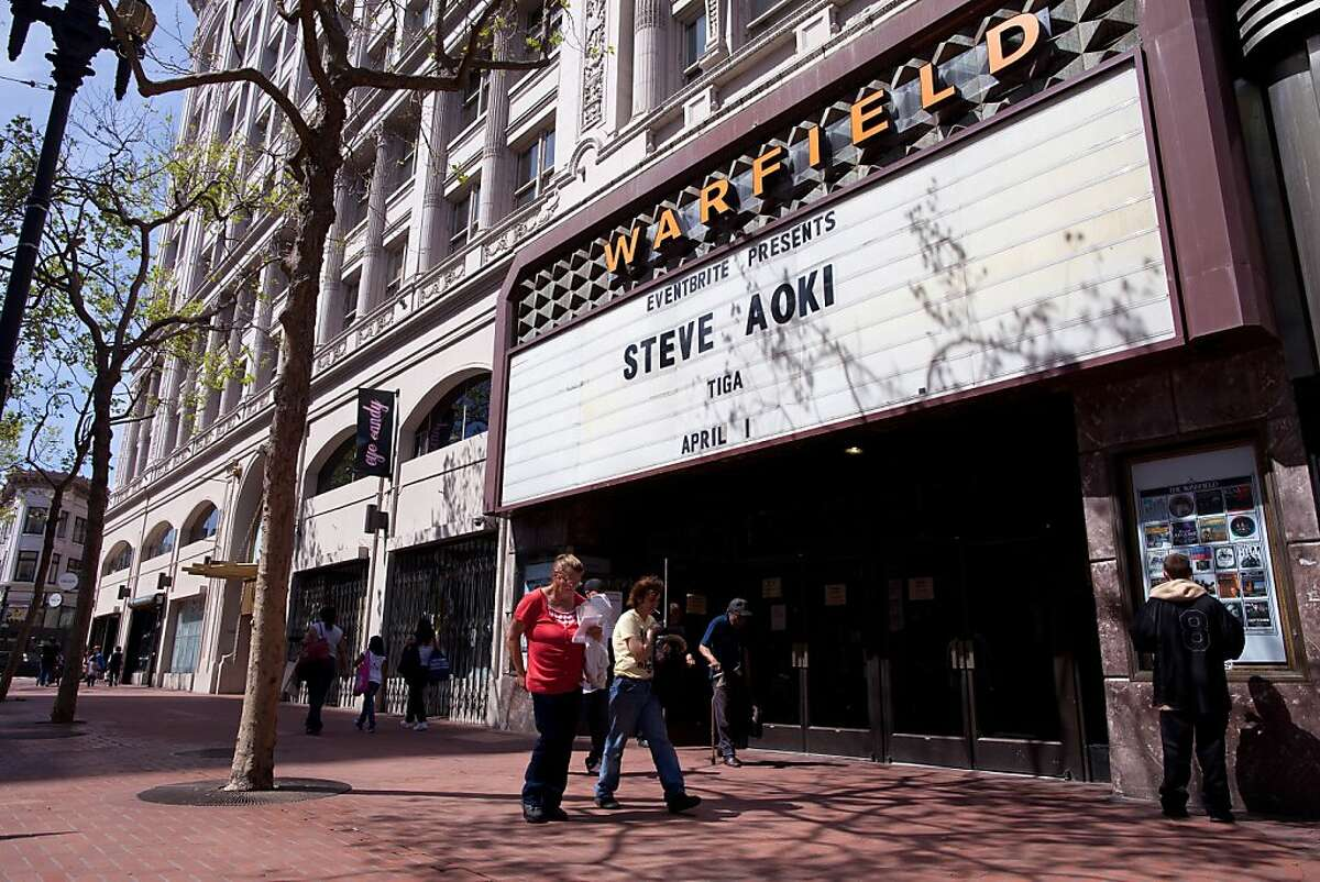 People walk in front of the Warfield on Market Street, April 1, 2011 in San Francisco, Calif. Photograph by David Paul Morris/Special to the Chronicle