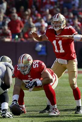Jonathan Goodwin (59) waits to hike the ball to Alex Smith. Jonathan Goodwin, the San Francisco 49ers reliable center, in his last playoff game against the New Orleans Saints.