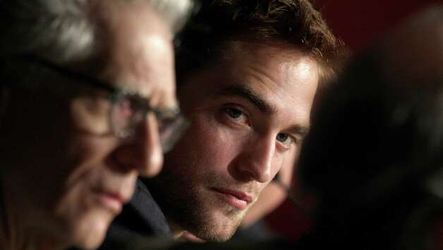 Actor Robert Pattinson, right, listens to questions during a press conference for Cosmopolis at the 65th international film festival, in Cannes, southern France, Friday, May 25, 2012. Photo: Virginia
