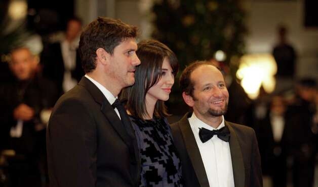 From right, director Carlos Reygadas and actors Nathalia Acevedo and Adolfo Jimenez Castro arrive for the screening of Post Tenebras Lux at the 65th international film festival, in Cannes, southern F