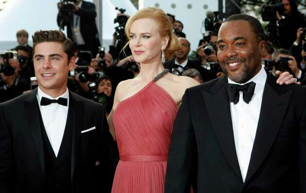 From left, actors Zac Efron, Nicole Kidman and director Lee Daniels arrive for the screening of The Paperboy at the 65th international film festival, in Cannes, southern France, Thursday, May 24, 201