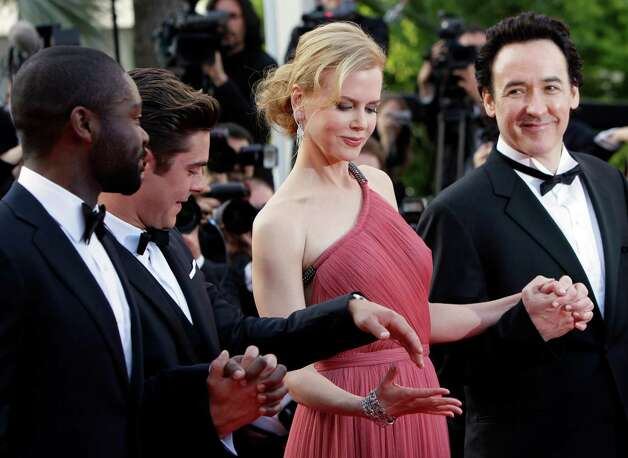 From left actors David Oyelowo, Zac Efron, Nicole Kidman and John Cusack arrive for the screening of The Paperboy at the 65th international film festival, in Cannes, southern France, Thursday, May 24