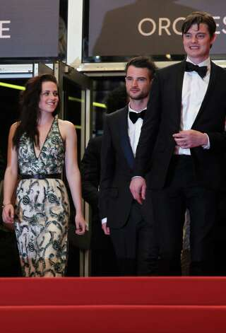 From left, actors Kristen Stewart, Tom Sturridge and Sam Riley depart  following the screening of On the Road at the 65th international film festival, in Cannes, southern France, Wednesday, May 23, 2