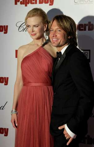 Actress Nicole Kidman, left, and musician Keith Urban arrive at the party for the paperboy at the 65th international film festival, in Cannes, southern France, Thursday, May 24, 2012. Photo: Francois