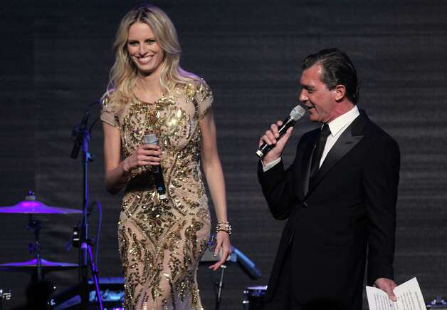 Karolina Kurkova and Antonio Banderas at the auction for the amfAR Cinema Against AIDS benefit during the 65th Cannes film festival, in Cap d'Antibes, southern France, Thursday, May 24, 2012. Photo: