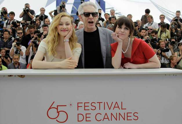 From left, actress Sarah Gadon, director David Cronenberg and actress Emily Hampshire pose during a photo call for Cosmopolis at the 65th international film festival, in Cannes, southern France, Frid