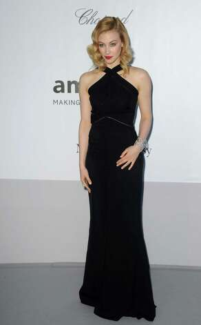Sarah Gadon arrives for the amfAR Cinema Against AIDS benefit at the Hotel du Cap-Eden-Roc, during the 65th Cannes film festival, in Cap d'Antibes, southern France, Thursday, May 24, 2012. Photo: Jon