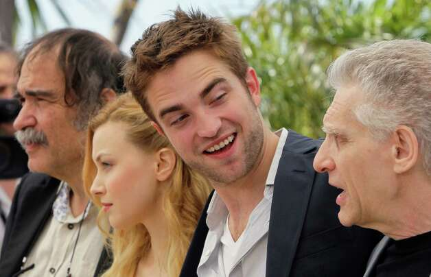 From left, producer Paulo Branco, actors Sarah Gadon, Robert Pattinson and director David Cronenberg pose during a photo call for Cosmopolis at the 65th international film festival, in Cannes, southe