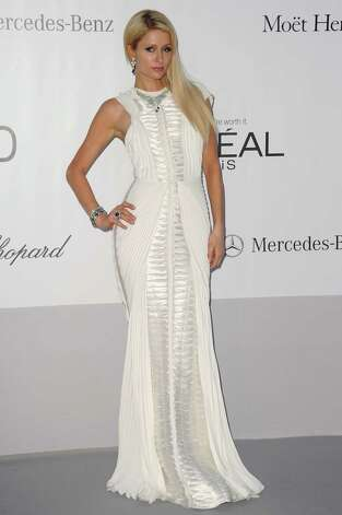 Socialite Paris Hilton arrives for the amfAR Cinema Against AIDS benefit at the Hotel du Cap-Eden-Roc, during the 65th Cannes film festival, in Cap d'Antibes, southern France, Thursday, May 24, 2012.