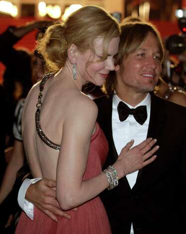 Actress Nicole Kidman, left, and musician Keith Urban depart following the screening of The Paperboy at the 65th international film festival, in Cannes, southern France, Thursday, May 24, 2012. Photo