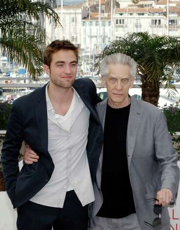 Actor Robert Pattinson, left, and director David Cronenberg pose during a photo call for Cosmopolis at the 65th international film festival, in Cannes, southern France, Friday, May 25, 2012. Photo: L