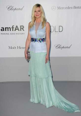 Kirsten Dunst arrives for the amfAR Cinema Against AIDS benefit at the Hotel du Cap-Eden-Roc, during the 65th Cannes film festival, in Cap d'Antibes, southern France, Thursday, May 24, 2012. Photo: J