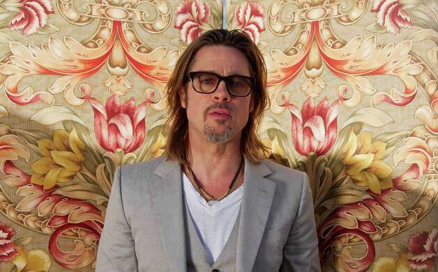 In this photo taken Wednesday, May 23, 2012. Brad Pitt poses for portraits for the film Killing Them Softly, during the 65th Film Festival in Cannes, France. Photo: Joel Ryan, AP / AP