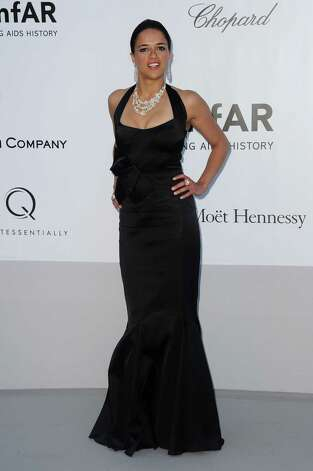 Michelle Rodriguez arrives for the amfAR Cinema Against AIDS benefit at the Hotel du Cap-Eden-Roc, during the 65th Cannes film festival, in Cap d'Antibes, southern France, Thursday, May 24, 2012. Pho