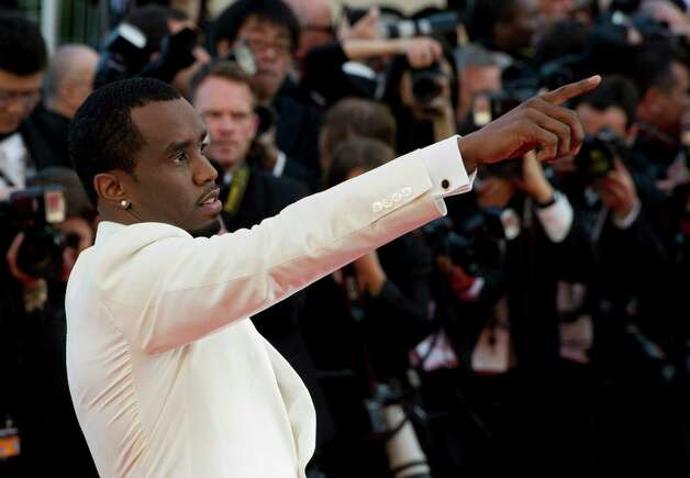 Singer Sean Combs gestures as he arrives for the screening of Killing Them Softly at the 65th international film festival, in Cannes, southern France, Tuesday, May 22, 2012. Photo: Jonathan Short, AP