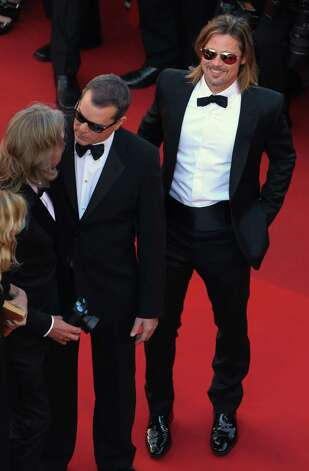 Actor Brad Pitt, right, smiles as actor Ray Liotta speaks to director Andrew Dominik, left, as they arrive for the screening of Killing Them Softly at the 65th international film festival, in Cannes,