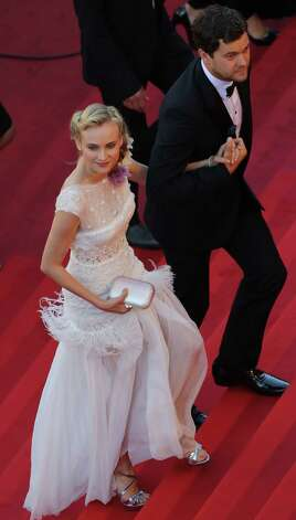 Actors Diane Kruger, left and Joshua Jackson arrive for the screening of Killing Them Softly at the 65th international film festival, in Cannes, southern France, Tuesday, May 22, 2012. Photo: Loic Ve