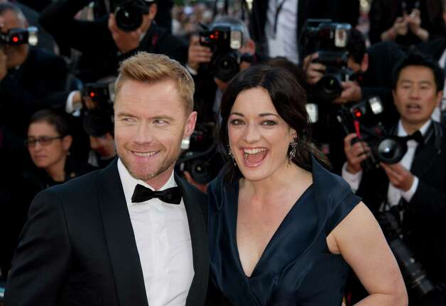 Musician Ronan Keating, left and actress Laura Michelle Kelly arrive for the screening of Killing Them Softly at the 65th international film festival, in Cannes, southern France, Tuesday, May 22, 201