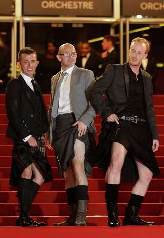 From left, actors Paul Brannigan, Gary Maitland  and William Ruane pose as they arrive for the screening of The Angel's Share at the 65th international film festival, in Cannes, southern France, Tues
