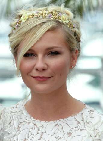 Actress Kirsten Dunst poses during a photo call for On the Road at the 65th international film festival, in Cannes, southern France, Wednesday, May 23, 2012. Photo: Joel Ryan, AP / AP