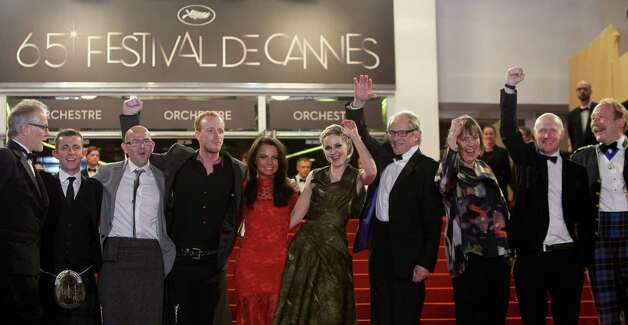 From left Cannes Film Festival artistic director Thierry Fremaux, actors Paul Brannigan, Gary Maitland , William Ruane, Jasmin Riggins, Siobhan Reilly, director Ken Loach, unidentified person, actors