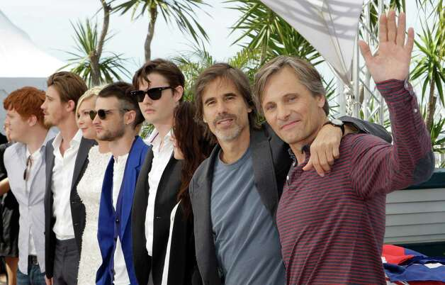 From left actors Danny Morgan, Garret Hedlund, Kirsten Dunst, Tom Sturridge, Sam Riley, Kristen Stewart, director Walter Salles and actor Viggo Mortensen pose during a photo call for On the Road at t
