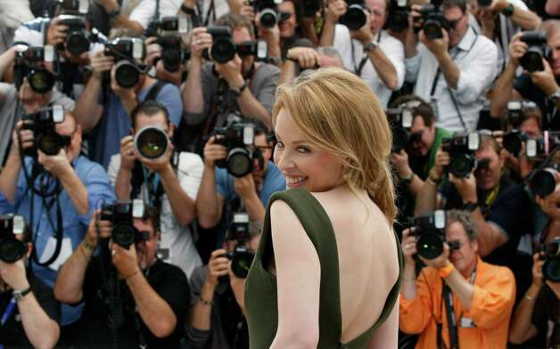 Actress Kylie Minogue poses during a photo call for Holy Motors at the 65th international film festival, in Cannes, southern France, Wednesday, May 23, 2012. Photo: Lionel Cironneau, AP / AP