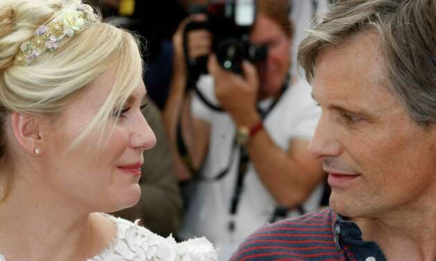 Actors Kirsten Dunst, left and Viggo Mortensen pose during a photo call for On the Road at the 65th international film festival, in Cannes, southern France, Wednesday, May 23, 2012. Photo: Lionel Cir