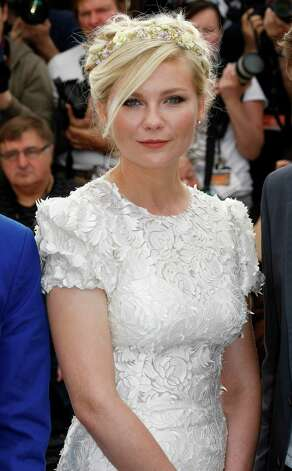 Actress Kirsten Dunst poses during a photo call for On the Road at the 65th international film festival, in Cannes, southern France, Wednesday, May 23, 2012. Photo: Lionel Cironneau, AP / AP