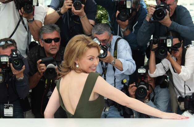 Actress Kylie Minogue poses during a photo call for Holy Motors at the 65th international film festival, in Cannes, southern France, Wednesday, May 23, 2012. Photo: Joel Ryan, AP / AP