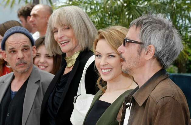 From left, actors Denis Lavant, Edith Scob, Kylie Minogue and director Leos Carax pose during a photo call for Holy Motors at the 65th international film festival, in Cannes, southern France, Wednesd