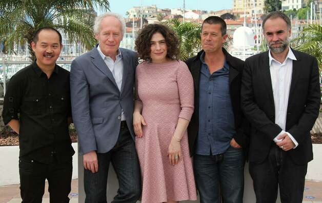 From left members of the jury Yu Lik-Wai, Jean-Pierre Dardenne, Arsinee Khanjian, Emmanuel Carrere and Karim Ainouz pose during a photo call for members of the Cinefondation Jury at the 65th internat