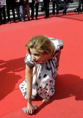 Actress Tea Falco drops her purse as she arrives for the screening of Me and You at the 65th international film festival, in Cannes, southern France, Wednesday, May 23, 2012. Photo: Francois Mori, AP