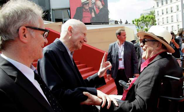 From left Cannes Film Festival artistic director Thierry Fremaux, President of Cannes Film Festival Gilles Jacob and director Bernardo Bertolucci greet each other as they arrive  for the screening of