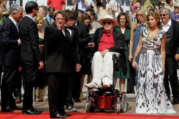 Director Bernardo Bertolucci, center, and actress Tea Falco, right, arrive for the screening of Me and You at the 65th international film festival, in Cannes, southern France, Wednesday, May 23, 2012