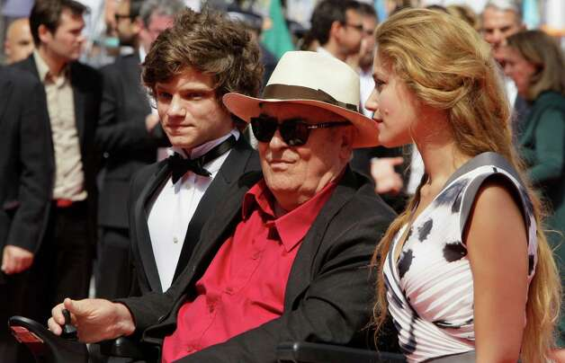 From left, actor Jacopo Olmo Antinori, director Bernardo Bertolucci and actress Tea Falco arrive for the screening of Me and You at the 65th international film festival, in Cannes, southern France, W