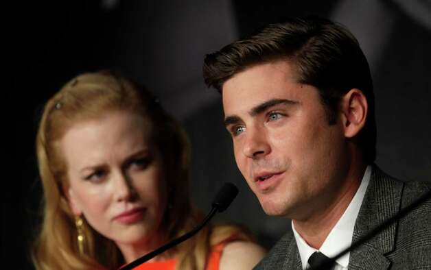 Actor Zac Efron, right, speaks as actress Nicole Kidman looks on during a press conference for The Paperboy at the 65th international film festival, in Cannes, southern France, Thursday, May 24, 2012