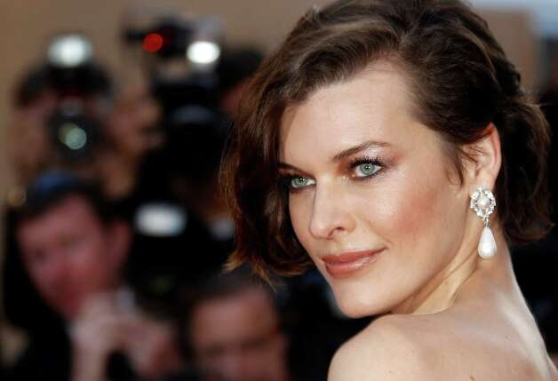 Model Milla Jovovich arrives for the screening of On the Road at the 65th international film festival, in Cannes, southern France, Wednesday, May 23, 2012. Photo: Joel Ryan, AP / AP