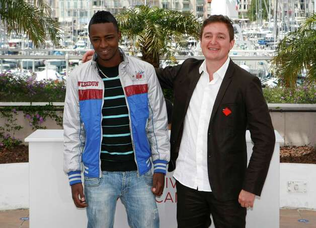 Director Juan Andres Arango, right, and actor Luis Carlos Guevara pose during a photo call for La Playa DC at the 65th international film festival, in Cannes, southern France, Thursday, May 24, 2012.