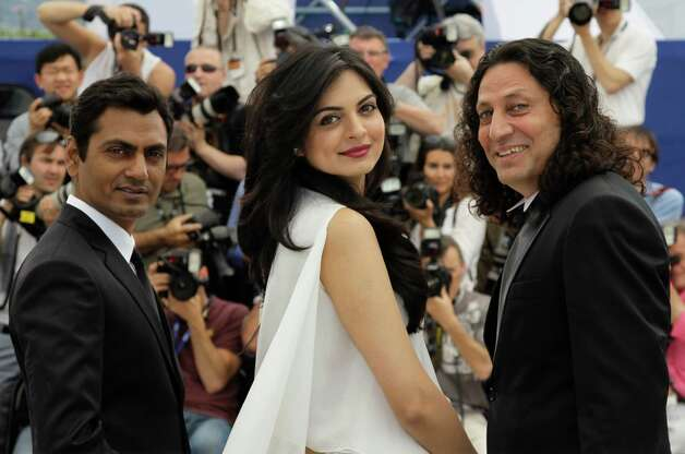 From left, actors Nawazuddin Siddiqui, Niharika Singh and Anil George pose during a photo call for Miss Lovely at the 65th international film festival, in Cannes, southern France, Thursday, May 24, 2