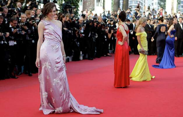 Model Milla Jovovich, left, arrives for the screening of On the Road at the 65th international film festival, in Cannes, southern France, Wednesday, May 23, 2012. Photo: Lionel Cironneau, AP / AP