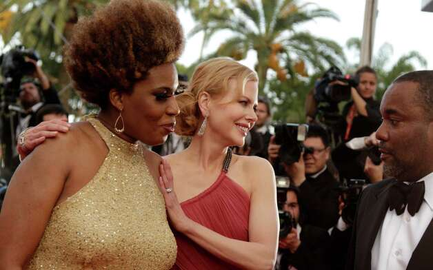 From left, actors Macy Gray, Nicole Kidman and director Lee Daniels arrive for the screening of The Paperboy, at the 65th international film festival, in Cannes, southern France, Thursday, May 24, 20